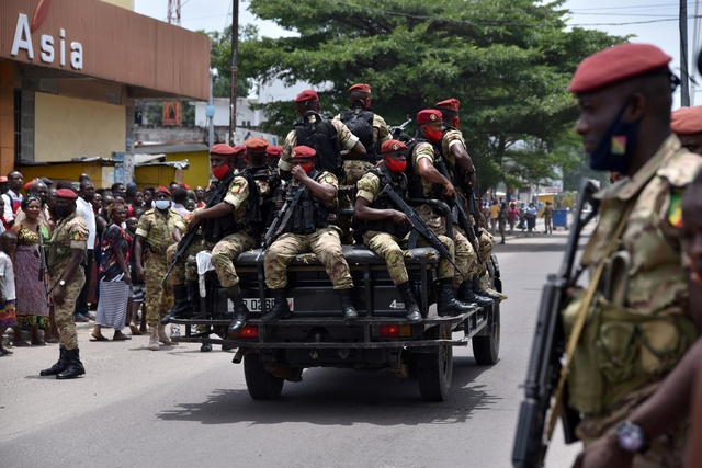 Soldiers from the Republic Guard escort incumbent President Denis Sassou Nguesso as he leaves the polling station in Brazzaville, March 21, 2021. REUTERS/Olivia Acland via GalloImages