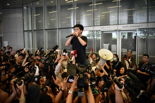 Prominent Hong Kong activists arrested after weeks of police violence at protests